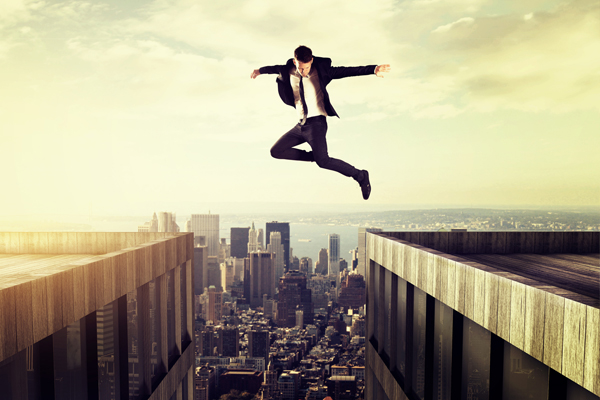Courage – Man Leaping Between Two Buildings